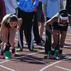 JIM VAIKNORAS/Staff photo <br /> Isabella Soule of Newburyport and Hamilton Wenham's Daniela Carcia at the start of the  100 meter heat at the CAL track meet at Pentucket Saturday.