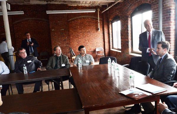 BRYAN EATON/Staff Photo. Amesbury  Mayor Ken Gray introduces Congressman Seth Moulton to business people.