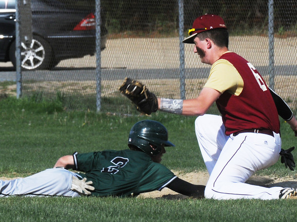BRYAN EATON/Staff Photo. Pentucket's Ryan DePaolo makes it back to first before Newburyport's Cam Rogers makes the tag.