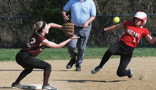 BRYAN EATON/Staff Photo. Amesbury's Maddie Napoli was called safe in this steal with Newburyport shortstop Annie Siemasko.