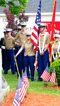 JIM VAIKNORAS/Staff photo Members of the Jr Marine ROTC guard the colors at the Memorial Day service in Seabrook Sunday morning.