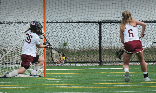 BRYAN EATON/Staff Photo. Newburyport goalie Izzy Sarra stops a shot by Manchester-Essex.