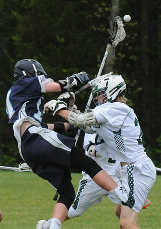 BRYAN EATON/Staff Photo. Triton's Brendan Muldowney and Pentucket's Liam Sheehy collide forcing a loose ball.
