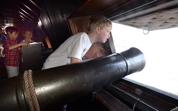 BRYAN EATON/Staff Photo. Josiah Fugate, 8, from Amesbury Elementary School checks out one of the cannon ports on the El Galeon.