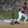 BRYAN EATON/Staff Photo. Triton's Tom Lapham eats the dirt on a double hit as Newburyport second baseman Brian Hadden waits for the throw.