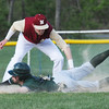 BRYAN EATON/Staff Photo. Newburyport shortstop Jack Calahane puts the tag on Pentucket's Ryan DePaolo.