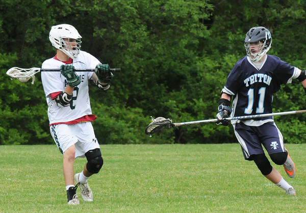 BRYAN EATON/Staff Photo. Triton's Brendan Muldowney moves in to cover Pentucket's Brandon Barlow.