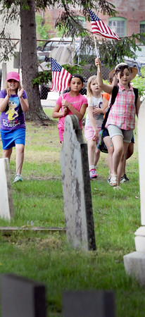 BRYAN EATON/Staff Photo. Youngsters from Amesbury Elementary School look for veteran's graves at the Corner Cemetery as they planted flad in honor of Memorial Day. They also visited the Polish Memorial and Mt. Prospect Cemetery on Wednesday.
