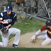 BRYAN EATON/Staff Photo. Vike's third baseman Coke Lojek juggles for the catch as Newburyport's Quin Stot steals the base.