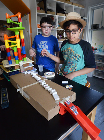 BRYAN EATON/Staff Photo. Sparhawk students Luca Guarracina, 9, left, and Chris Douglas, 11, with a Rube Goldberg-type set up in a tinkering part of science class.