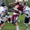 BRYAN EATON/Staff Photo. Newburyport's Will Fogel gets sandwiched between two Triton defenders.