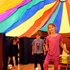 BRYAN EATON/Staff Photo. Kindergartners are learning to play soccer in physical education class at the Bresnahan School in Newburyport. To make the dribbling excercise a little more fun, teacher Jesse Craddock created an obstacle course which went under this colorful parachute.