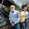 BRYAN EATON/Staff Photo. Tom Pendergast, left, with a circa 1830 Charise carriage. Other Amesbury Carriage Museum members, Peter Hoyt, John Mayer, executive director and Susan Koso.