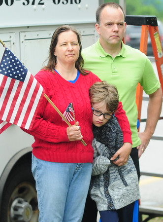 JIM VAIKNORAS/Staff photo Joanna and Ken Crooks along with their son Cameron, 9, attend  the Memorial Day service in Seabrook Sunday morning. THeir daughter Hannah was also there performing with the Winnacunnet High School band.