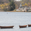 JIM VAIKNORAS/Staff photo Three dories in the Merrimack River at Lowell's Boat Shop in Amesbury.