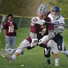 BRYAN EATON/Staff Photo. Newburyport's Harrison Good and Triton's Alec Sirois go for the loose ball.