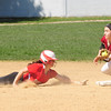 JIM VAIKNORAS/Staff photo Amesbury Caity Baker dives safely back to second during the Indian's game against Concord Carlise at Amesbury.