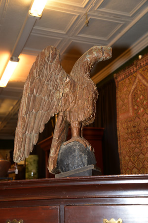 JIM VAIKNORAS/staff photo An eagle from the roof of a Newburyport home up for auction at John McInnis Auctioneers in Amesbury.