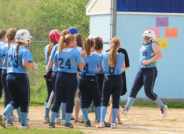JIM VAIKNORAS/Staff photo Triton's Julia Hartman is greeted by her teammates after hitting a home run against Pentucket during their game at Triton Wednesday.
