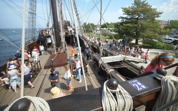 JIM VAIKNORAS/Staff photo Visitors make their way around El Galeon on a hot Saturday afternoon Saturday along the Newburyport waterfront.