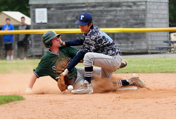 JIM VAIKNORAS/Staff phot Pentucket's Jacob Deziel gets back safely to second as Triton's Dylan Copeland tries to make a play during the Spofford tournament in Georgetown Sunday.