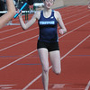 BRYAN EATON/Staff Photo. Triton's Bridget Moran in the 4 x 800 relay.