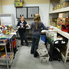 BRYAN EATON/Staff Photo. Our Neighbor's Table volunteers Stacy Gijsbers, left, and Catherine Barkley sort recent food donations collected by the U.S. Postal Service in the warehouse area.