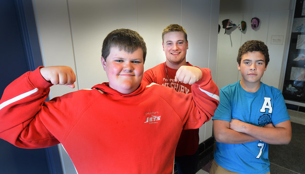 BRYAN EATON/Staff Photo. Thomas Flanagan, 14, left, and Kaiden Henderson, 14, right with teacher Patrick Foley.