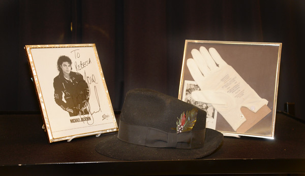 JIM VAIKNORAS/staff photo An autographed photo of Michael Jackson along with his hat and glove up for auction at ohn McInnis Auctioneers in Amesbury.