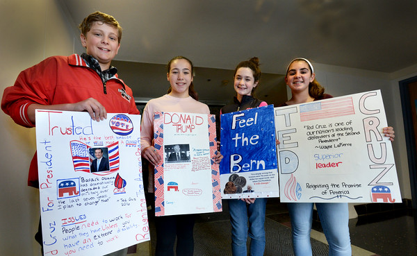 BRYAN EATON/Staff Photo. Seventh-graders at Amesbury Middle School are having quite the lesson in civics class with the rollercoaster ride of this year's presidential election. Showing the support of their candidate, from left, Tim Gilleo, Brianna Morel, Emma