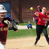 JIM VAIKNORAS/Staff photo Amesbury's Adrienne Harris throws out a runner during the Indian's game against Concord Carlise at Amesbury.