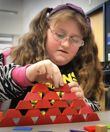 BRYAN EATON/Staff Photo. Elizabeth Bell, 8, creates a pyramid in art class at Salisbury Elementary School on Tuesday morning. They were learning about geometric abstraction turning organic objects into geometric shapes.