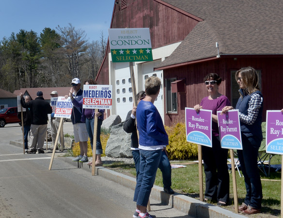 BRYAN EATON/Staff Photo. People poll for their candidates outside the Hilton Center in Salisbury.
