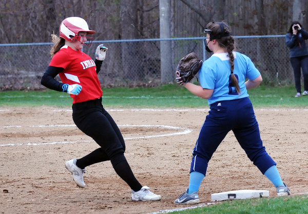 BRYAN EATON/Staff Photo. Amesbury's Hayley Catania makes it to third on a single by Emily Robinson.