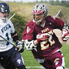 BRYAN EATON/Staff Photo. Newburyport's Cullen Heath moves the ball past Triton's Nolan Smith.