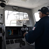 BRYAN EATON/Staff Photo. Reggie Santos of the Salisbury Harbormaster department keeps his eye on the ship.