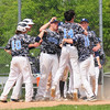 JIM VAIKNORAS/Staff photo Teammates congradulates Lewi L'Huereux's home run against  Essex Tech Saturday at Triton.
