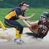 BRYAN EATON/Staff Photo. Newburyport's Annie Siemasko makes the steal to second as the Lynnfield shortstop waits for the throw.