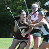 BRYAN EATON/Staff Photo. Newburyport's Sami Kelleher gets pressure from Pentucket's Brooke Yemma.