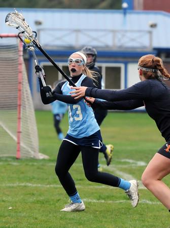 BRYAN EATON/Staff Photo. Triton's Skyla Lewis readies for a throw to a teammate.