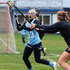 BRYAN EATON/Staff Photo. Triton's Skyla Lewis readies for a throw to a teammate.