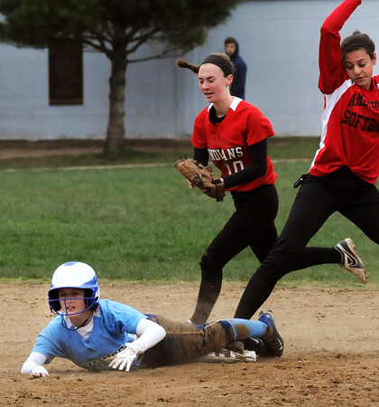 BRYAN EATON/Staff Photo. Triton's Kendall Mitchell looks for the call which is out at second base.