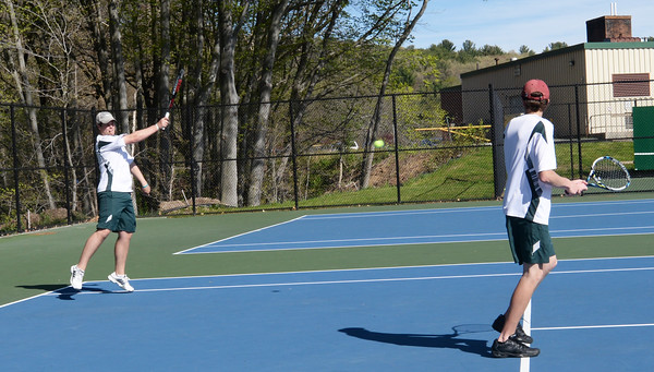 BRYAN EATON/Staff Photo. First doubles' Max Jackson, left, and Ben Brackbill.