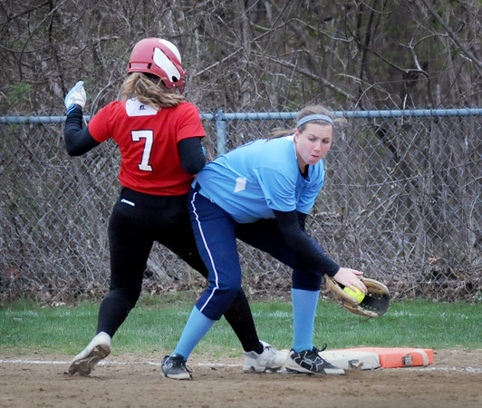 BRYAN EATON/Staff Photo. Triton first baseman Emma McGonagle has the throw but Amesbury's Hayley Catania makes it back safely while leading to steal.