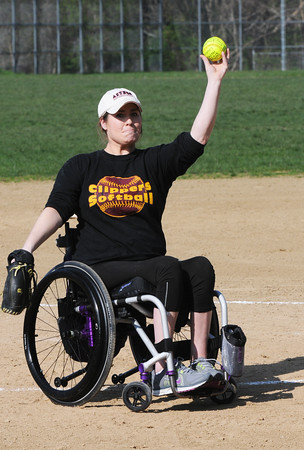 BRYAN EATON/Staff Photo. 2004 Newburyport HIgh School graduate and softball pitcher Jackie Colby throws out the first pitch of the Newburyport at Amesbury game yesterday.