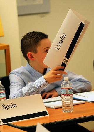 JIM VAIKNORAS/Staff photo  Daniel Russell votes on behalf of the UKraine atthe Model UN at Newburyport High School Saturday.