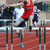 BRYAN EATON/Staff Photo. Freddie Halloran in the 400 hurdles.