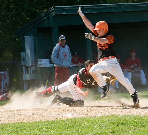 JIM VAIKNORAS/Staff photo Amesbury's .. tags out Ipswich's Jake Long in the first inning duringtheir game at Amesbury Thursday.