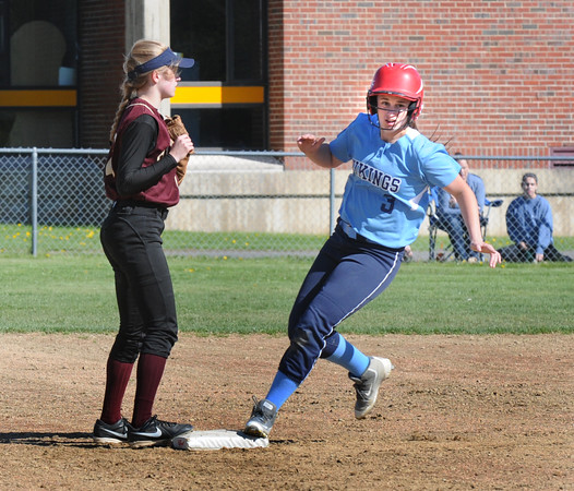 BRYAN EATON/Staff Photo. Triton's Bridget Sheehan makes it to second on a hit by Grace McGonagle.