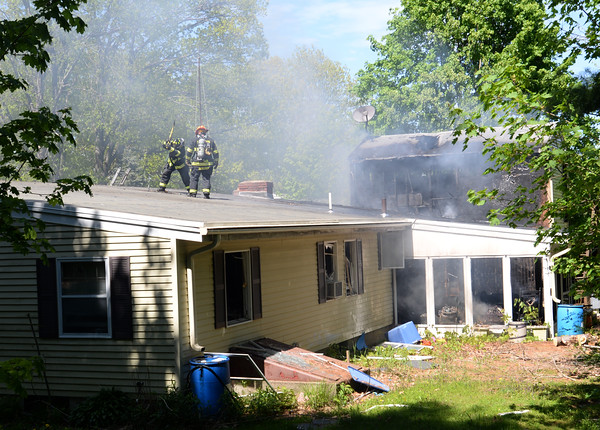 BRYAN EATON/Staff Photo. Firefighters from Amesbury and surrounding towns battle a fire that apparently started in this two-story garage on 22 Fern Avenue in Amesbury and jumped to the house.